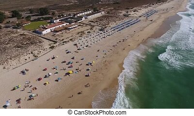 Aerial. Flying over summer beach Barril. Tavira Portugal