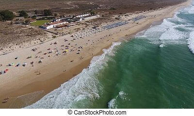 Aerial. View Barril beach with holidaymakers, from the sky...