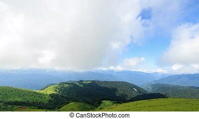 Mountains with forest and clouds. Time Lapse. Sochi, Russia....