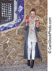 smiling tourist woman at Guell Park in Barcelona at...