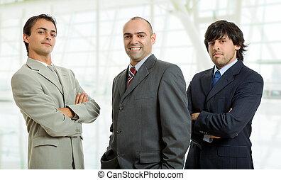business men - three businessmen at the office