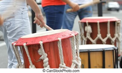 Street musician playing drums wooden drumsticks