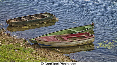 Three old boats along the river