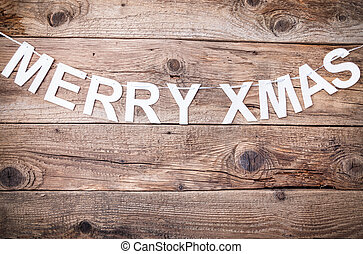 Merry Christmas sign on wooden background