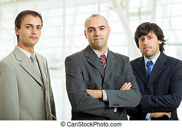 team - three business men at the office