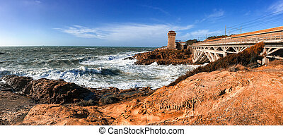 Sea storm in Calafuria, Leghorn. Panoramic view of Tuscany...