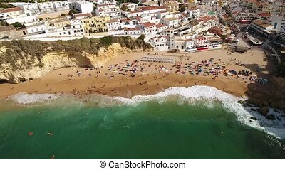 Aerial. Shooting from the sky, the beach and the of tourists village of Carvoeiro. Portugal.