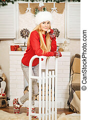 Beautiful girl in the decorated Christmas room.