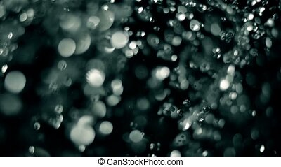 Abstract waterd drops fly over dark background - Abstract...