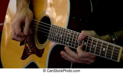 Man plays acoustic guitar