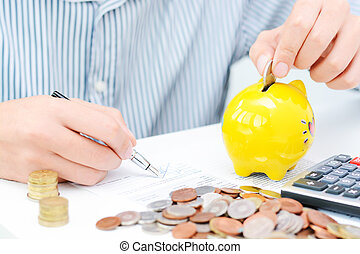 Retirement plan or savings concept with yellow piggy bank