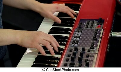 Musician plays a synthesizer at concert