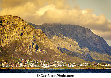Hermanus At Sunset - Sunset clouds over mountains at...