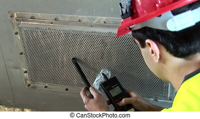 Measuring air quality in ventilator shaft - Over shoulder on...
