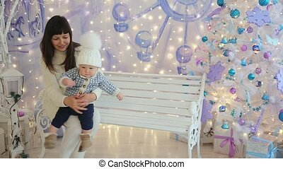 Mother and son in the studio Christmas sitting on the bench
