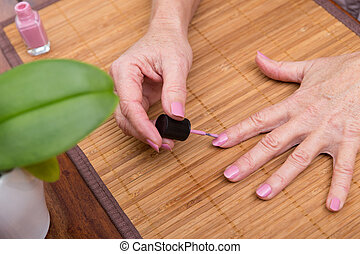 closeup of hands with nail enamel - closeup of hands with...
