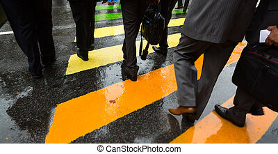 People cross street at rainy day - People cross street at...
