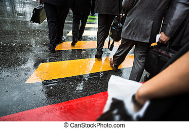 People cross street at rainy day - People cross street at...