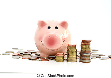 Pink piggy bank standing on coins, suggesting money savings...