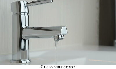Weak water pressure flowing from a chrome tap - The weak...