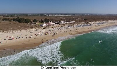 Aerial. Barril beach view from the sky, tourists on...