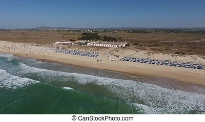 Aerial. Barril beach resort view from the sky, tourists on...