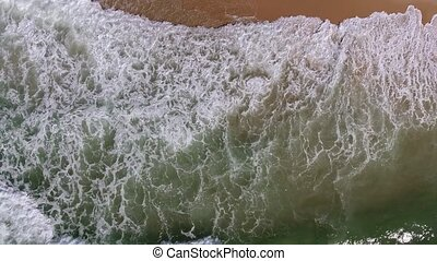 Aerial. The movement of the waves on the beach from the sky. Portugal.