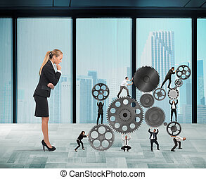 Boss builds a business team - Businesswoman watches a...
