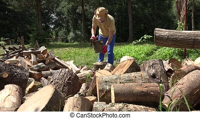 man chop wood with axe yard. Firewood preparation for winter. 4K