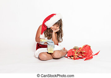 Smiling little girl is looking at an inappropriate gift -...