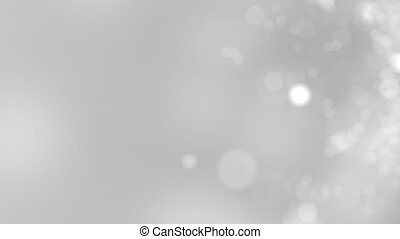 Grey motion background. Abstract glowing bokeh circles or...