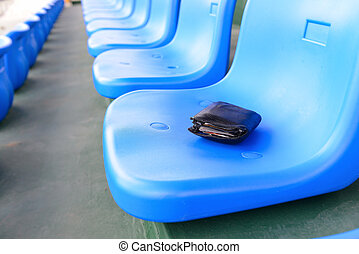 lost wallet lying on a stadium seat