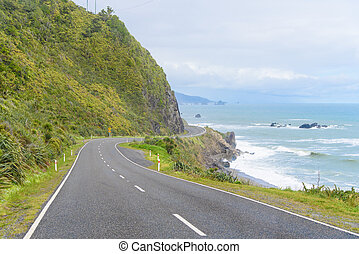 New Zealand Coastal Highway: A scenic road winds along the...