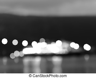 Black and white Norway night ship with lights bokeh...