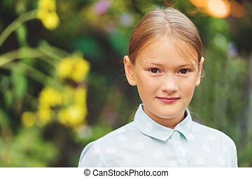 Close up portrait of a cute 9-10 year old girl