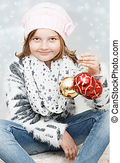 girl with Christmas bulbs - cute young girl with Christmas...