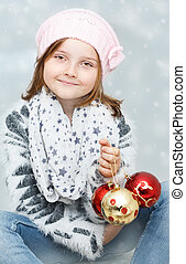 girl with Christmas bulbs - smiling young girl with...