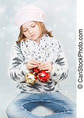 girl with Christmas bulbs - dreamy young girl with Christmas...