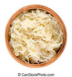 German sauerkraut in wooden bowl over white. Finely cut...