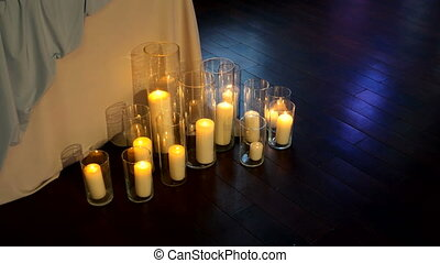 Candles in vases, decorative interior element for banquet.