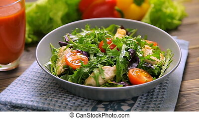 Fresh salad with chicken, tomatoes, arugula, mesclun, basil...