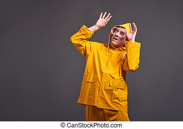 Man in yellow raincoat - A middle aged man in a yellow...