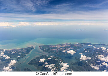 View from airplane window - Land, sea and estuary from...