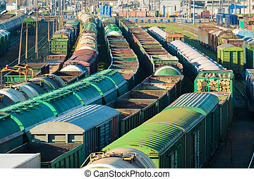 Train cargo station with lots of cars tanks and...