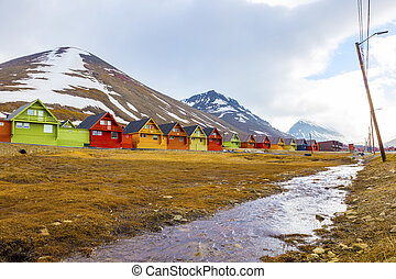 Row of colorful wooden houses at Longyearbyen in Svalbard -...