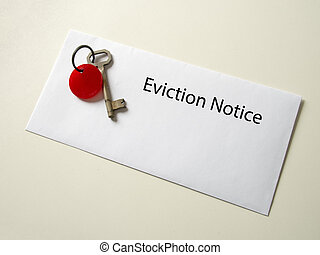 Eviction notice. Real old key on real envelope on real cream...