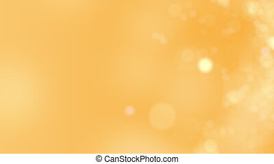 Yellow motion background. Abstract glowing bokeh circles or sparks. 4K seamless loop animation