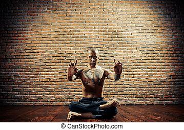 yoga guru - Lotus pose. Yoga master practicing yoga....