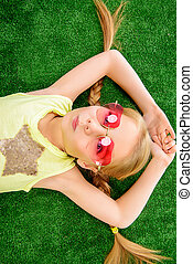 funny pigtails - Cheerful little girl in colorful clothes...