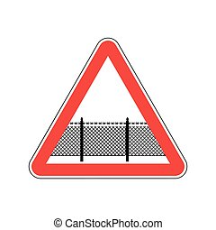 Warning sign attention with barbed wire fence. Note border...